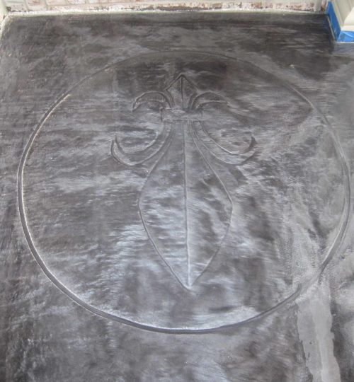 Metallic Epoxy over Medallion by Concrete Mystique Engraving